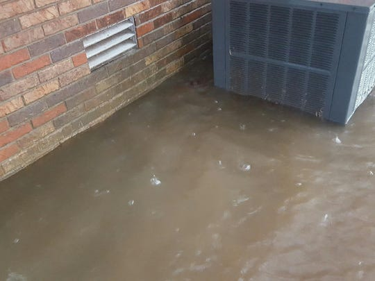 Flooding in the area submerges an air conditioning