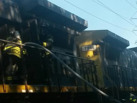 Firefighters working fire to CSX locomotive in Congers