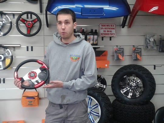 Justin Lokotar shows an upgraded golf cart steering