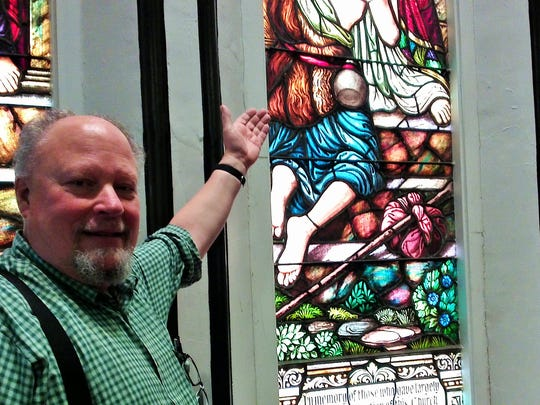 Rev. Jamie Stevens by his favorite stained-glass window