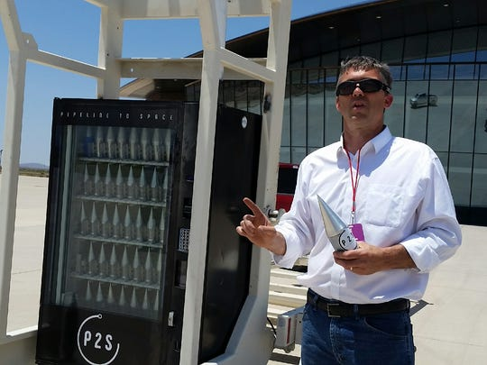 Mark Russell, CEO of P2S suborbital spaceflight company, holds a sample capsule that will be used to launch tiny payloads from Spaceport America. Russell said Wednesday the company will start test flights next week.