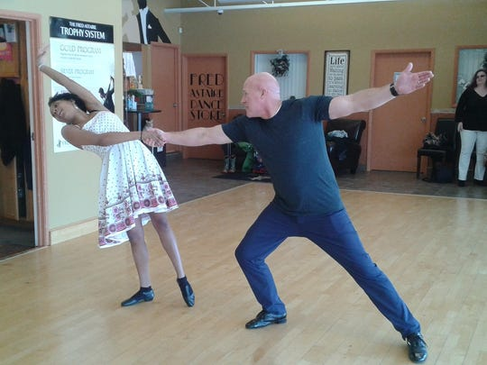 Teacher Janique Sanders and Mike Kulka work on moves for Dancing with the St. Regis Stars.