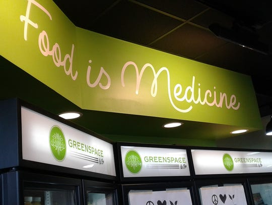 "The sign ""Food is Medicine"" explains the mission behind"