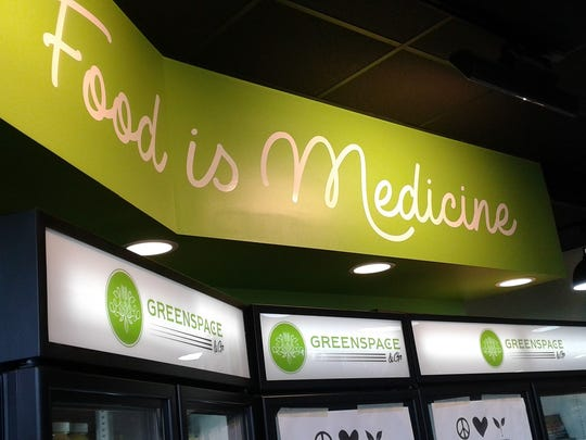 """The sign """"Food is Medicine"""" explains the mission behind"""