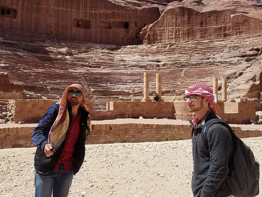A guide explains the Roman Theater at Petra