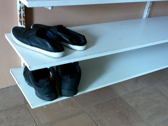Shelves where shoes are placed when people enter building,