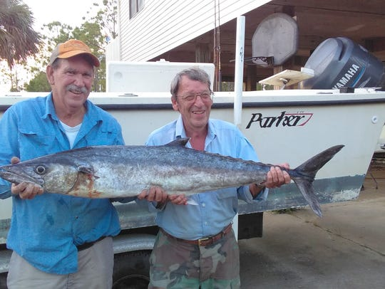 Charlie Putnum (L) and his fishing partner Byron caught