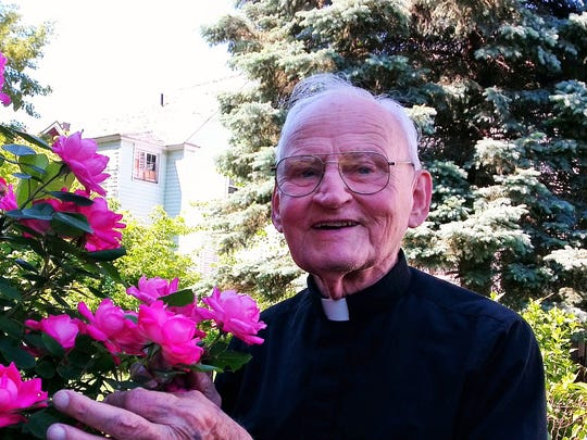 Rev. Alfred Bebel, shown in his garden in Binghamton, is  celebrating his 60th anniversary as a priest.