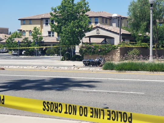 Portions of Tapo Street in Simi Valley remain blocked as police investigate a fatal motorcycle crash on Monday. Police advised motorists to a avoid the area until 5 p.m.