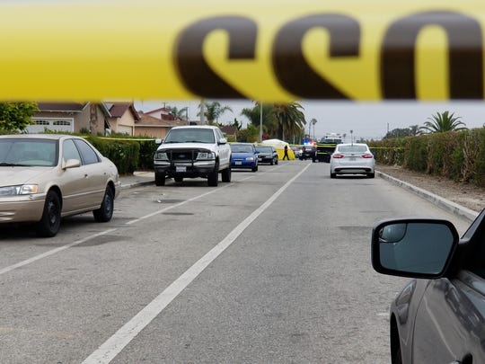 Police tape blocks portions of South J Street in Oxnard Wednesday morning as police investigate a homicide.