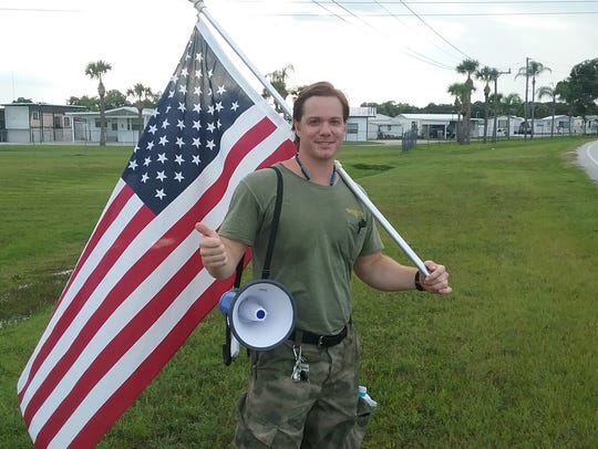 Jonathon Norris was demonstrating outside the Space Coast Convention Center Saturday.