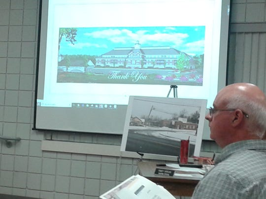 Developer Ray LeDuc listens to public comments after presenting a slide show of his proposed project to Milford planning commissioners.