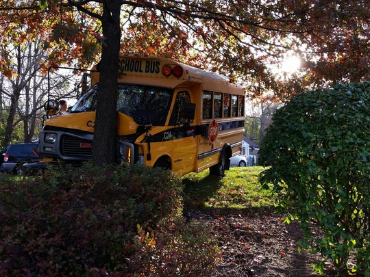 A school collided with a car and struck a tree at Route 303 in Valley Cottage Tuesday, Nov. 4. Three children and a school-bus driver were taken to Nyack Hospital with minor injuries.
