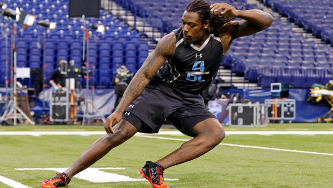 South Carolina defensive lineman Jadeveon Clowney runs a drill at the NFL football scouting combine in Indianapolis. He is a top prospect in the upcoming NFL draft.