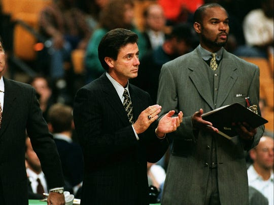 In this photo from 1997, Rick Pitino, who was the head coach of the Boston Celtics, is seen with his assistant coach Winston Bennett.