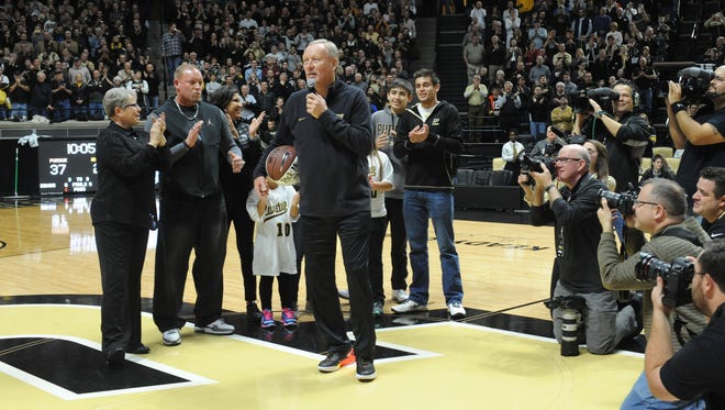 Rick Mount, surrounded by his wife Donna, family and a host of media, tells a standing crowd at Mackey Arena of his days at Purdue.