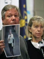 Robert and Charlene Spierer displays a photo of thier missing daughter Lauren Spierer taken by a video surveillance camera in her apartment building on the night she disappeared during a news conference in Bloomington, Ind., Wednesday, June 15, 2011. Spierer, 20, of Greenburgh, N.Y., was last seen early June 3 walking alone toward her apartment after a night of drinking with friends.  (AP Photo/Michael Conroy)