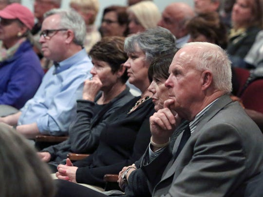 Attendees listen to Democratic mayoral candidates during a debate Wednesday at the Delaware Art Museum.