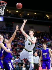 Patrick McCaffery of Iowa City West drives to the basket