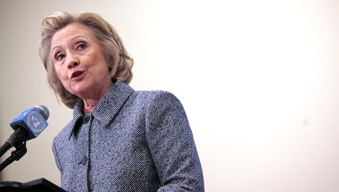 Former secretary of State Hillary Clinton speaks to reporters Tuesday.