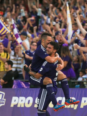 Louisville City's Chandler Hoffman celebrates with teammate Cameron Lancaster after Lancaster's assist to Hoffman resulted in a goal early in the second half against Charleston Saturday night.