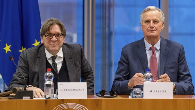 European Parliament Brexit coordinator Guy Verhofstadt, left, and European Union chief Brexit negotiator Michel Barnier talk at the start of a Brexit Steering Group meeting at the European Parliament in Brussels on Jan. 30, 2019. British