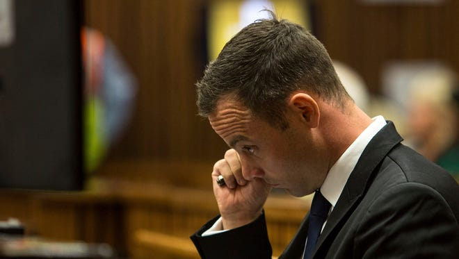 Oscar Pistorius wipes his face on Day 11 of the trial.