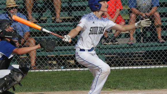 Cohen Henry hits a home run for Sioux Falls Little League on Monday against Fargo in Rapid City.