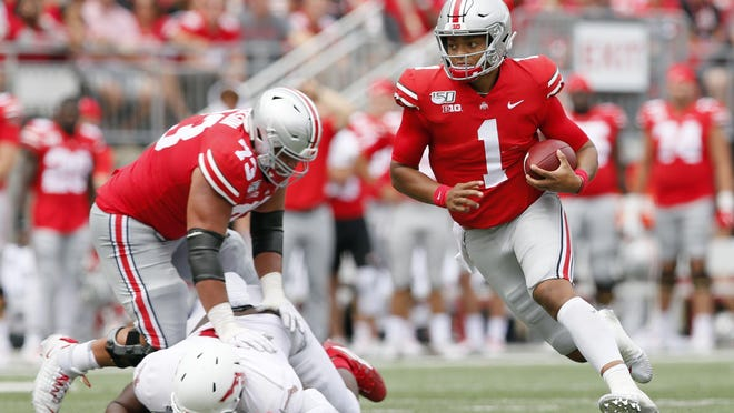 Ohio State, led by star quarterback Justin Fields (1), was ranked No. 2 in the preseason coaches poll. Now, the Buckeyes and other Big Ten teams will remain idle until at least next spring.