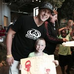 Trevor Bayne with Drew Stuart, 6, at Detroit's Outdoor Adventure Center. Bayne, 28th in the Sprint Cup standings, and his Roush Fenway Racing teammates hope to change their luck.