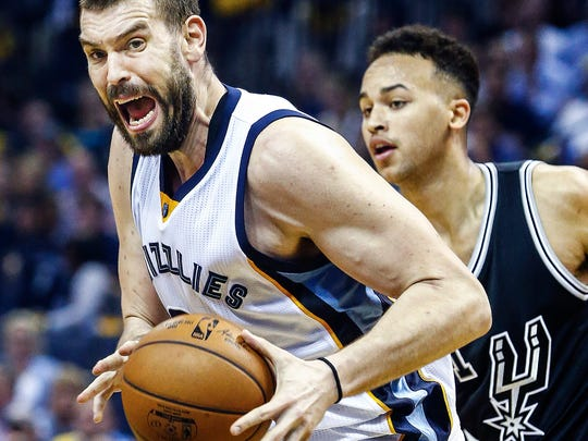 Memphis Grizzlies center Marc Gasol (left) drives the lane against San Antonio Spurs defender Kyle Anderson (right) during second-quarter action in Game 3 of their first-round series at the FedExForum on April 20, 2017.