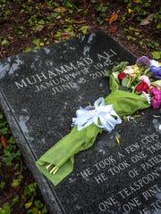 Flowers left on Muhammad Ali's gravesite at Cave Hill