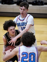 Webster County's Tyler Camplin (2) drives the basketball