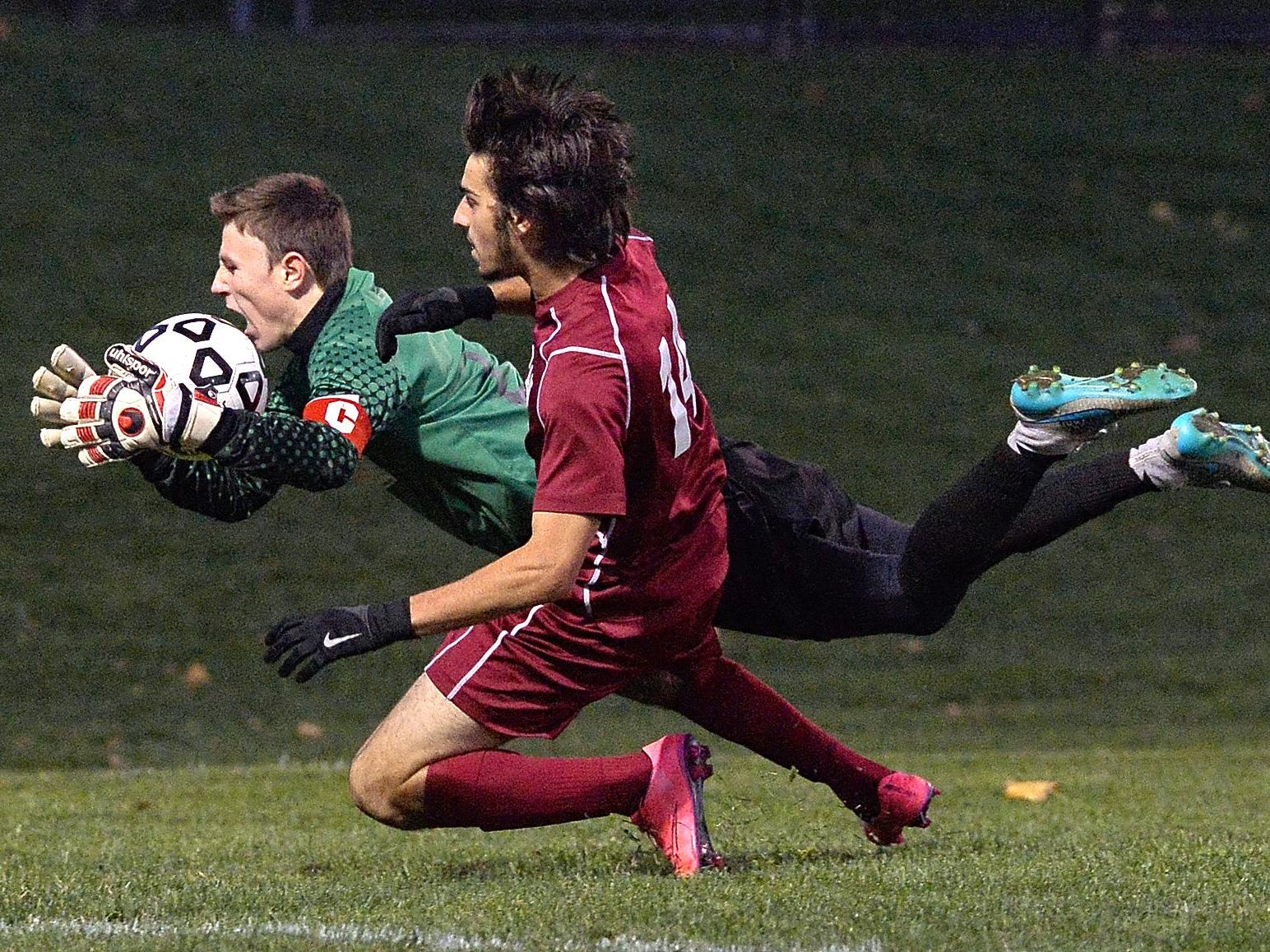 Hilton goalie Brian Wilkin, left, dives for the ball and collides with Walt Whitman's Anthony Palazzolo during a NYSPHSAA Boys Soccer Championships Class AA semifinal played at Middletown High School on Saturday, November 14, 2015. Hilton's season ended with a 7-3 loss to Walt Whitman-XI.
