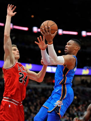 Oklahoma City Thunder's Russell Westbrook (0) goes up to shoot against Chicago Bulls' Lauri Markkanen (24) during the second half.