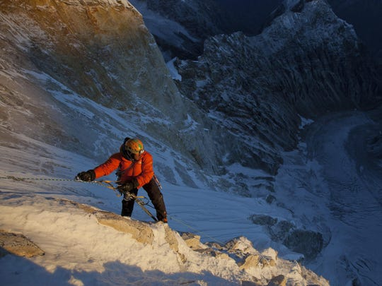 Jimmy Chin makes his way up the Shark's Fin route of Meru in the Himalayas.