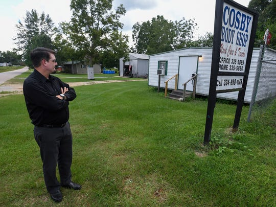 Brent Cosby, shown on Thursday August 10, 2017 in Rutledge, Ala., looks at the building his father Earl Cosby was murdered in on June 13, 2016.