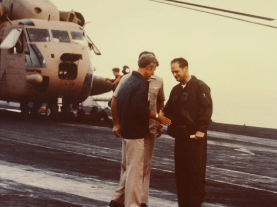 "Retired U.S. Marine Corps Lt. Gen. Charles ""Chuck"" Pitman shakes hands with personnel during the 1979 mission to rescue hostages in Iran."