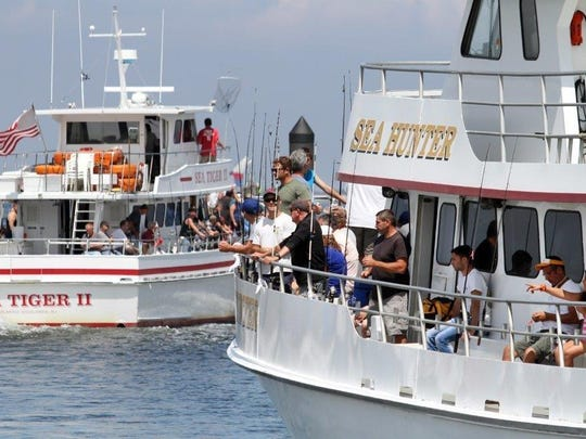 Anglers heading out for a day of fishing on a pair of party boats.