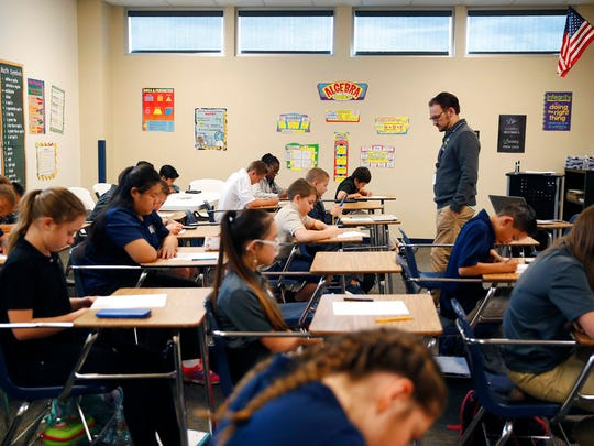 In this Nov. 16, 2017, photo, students take a quiz in Michael Briggs' seventh grade algebra class at Lake Mead Christian Academy in Henderson, Nev.