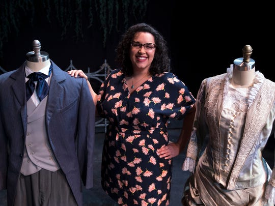 """Alexandria Vazquez, 30, of Fort Myers, is the Resident Costume Designer and Costume Shop Manager at the Florida Repertory Theater. In the background are costumes from the theater's current play """"The Miracle Worker""""."""