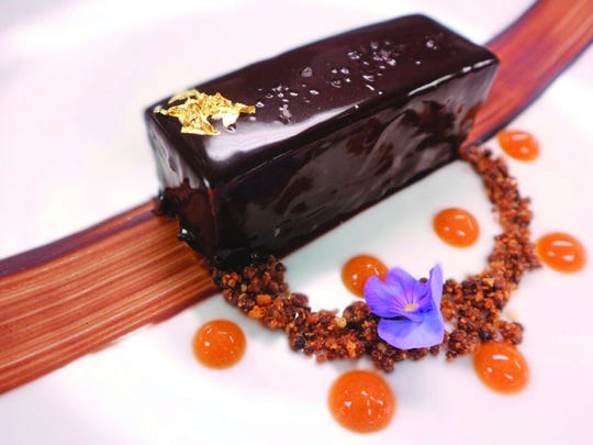 Save room for the Lingotto al Cioccolato: chocolate ganache in a hazelnut crust with sea salt caramel and gold leaf.
