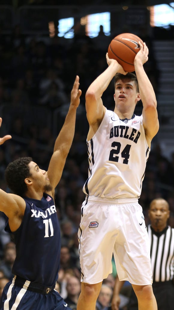 Butler's Kellen Dunham shoots a 3-pointer over Xavier's Dee Davis in the first half of a game at Hinkle Fieldhouse on Jan. 10, 2015.