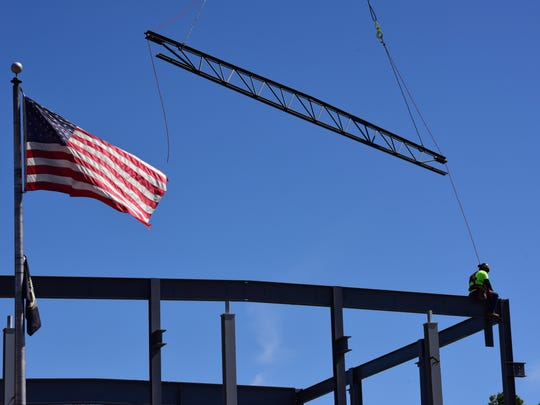 A contractor on a beam as the new municipal building