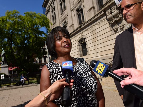 Paterson City Council President Ruby Cotton says the city has no choice but to borrow the money because of provisions in municipal labor contracts.