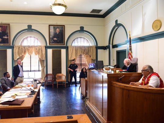 Chief Dwaine Perry, right, of the Ramapough Lenape Nation testifies Tuesday before Judge Roy F. McGeady at the Bergen County Courthouse in a dispute with the township of Mahwah.