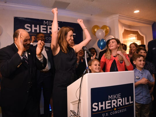 Mikie Sherrill celebrates her win in the 11th district