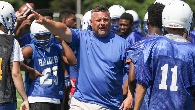 North Brunswick football coach Don Zsak runs practice on August 12.