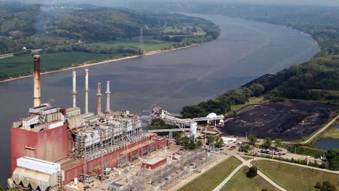A band of diesel fuel flows down the Ohio River  from Duke Energy's Beckjord station near New Richmond where about 5,000 gallons of diesel fuel were spilled during a transfer at the station.