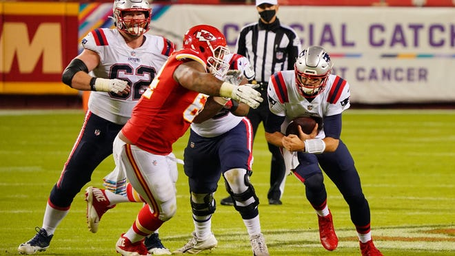 New England Patriots quarterback Jarrett Stidham (4) runs the ball against Kansas City Chiefs defensive tackle Mike Pennel (64) during the fourth quarter of a NFL game at Arrowhead Stadium on Oct. 5, 2020.